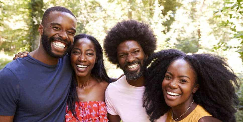 A group of young, smiling, black people.